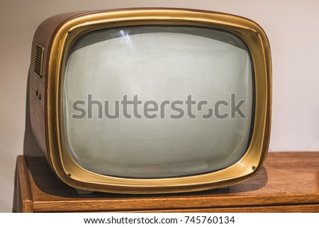 Picture of old vintage tv on the wooden shelf