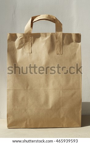 Picture of paper bag over white wall