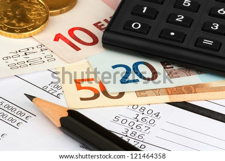 PICTURE OF PAPERS, MONEY, CALCULATOR AND A PENCIL - stock photo
