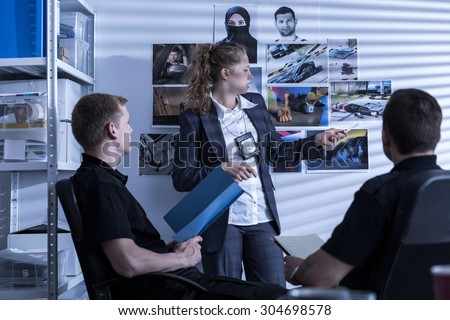 Picture of police team during investigation watching evidences - stock photo