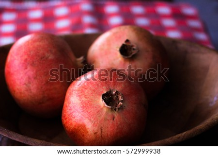 Picture of pomegranate, with a home style background