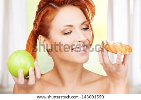 picture of pretty woman with apple and cake - stock photo