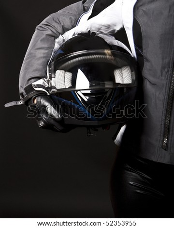 Picture of racing helmet in hands - stock photo