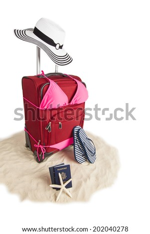 Picture of Red Suitcase Ready for Travel To Beach Vacation With Sandals, Sand, Beach Hat, Star Fish, Passport and Flip Flops - stock photo