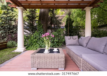 Picture of relaxation space in garden with elegant rattan furniture