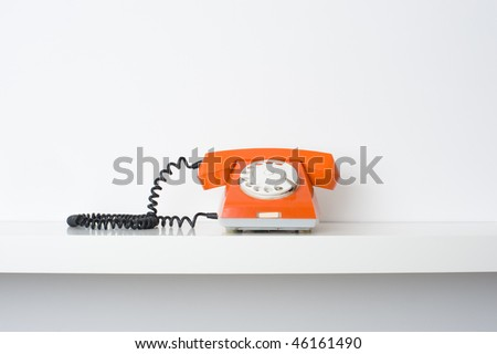 Picture of retro telephone on shelf. Many lot of copyspace