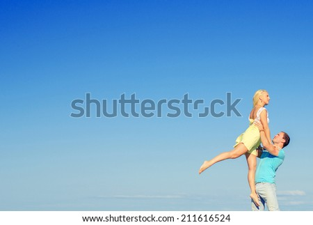 Picture of romantic young couple dancing. Space for text. - stock photo