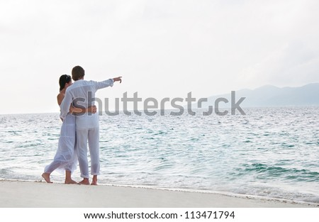 Picture of romantic young couple on the sea shore - stock photo