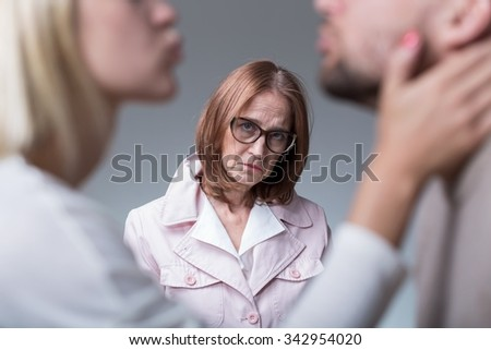 Picture of sad woman suffering from sick motherly love