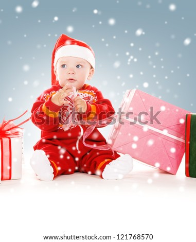 picture of santa helper baby with christmas gifts - stock photo