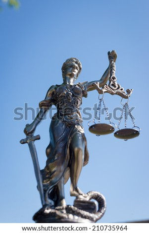 picture of sculpture of themis, femida or justice goddess on bright blue sky outdoors copy space background - stock photo