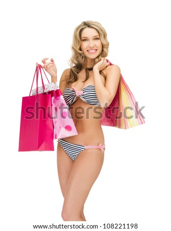 picture of seductive woman in bikini with shopping bags