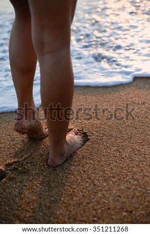 Picture of Sexy Legs on Tropical Sand Beach. Walking Female Feet. Closeup
