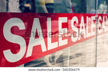 Picture of shop window display with text Sale on red poster - stock photo