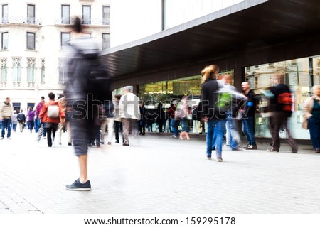 picture of shopping people on the move in the city with intentional motion blur