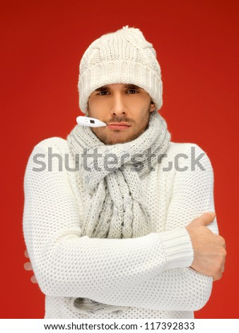 picture of sick man with thermometer in his mouth