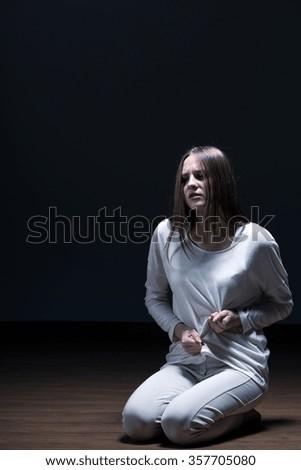 Girl Stomachache Sitting On Room Floor Stock Photo