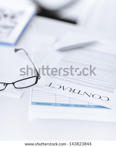 picture of signed contract paper with glasses