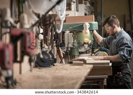 Picture of skilled carpenter using new technology at work - stock photo