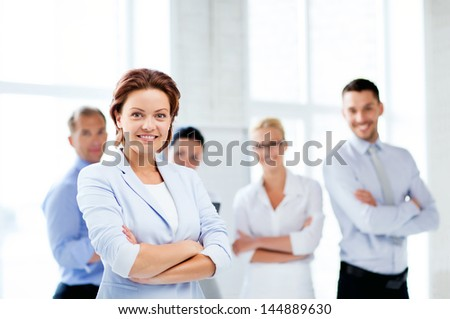 picture of smiling attractive businesswoman in office - stock photo