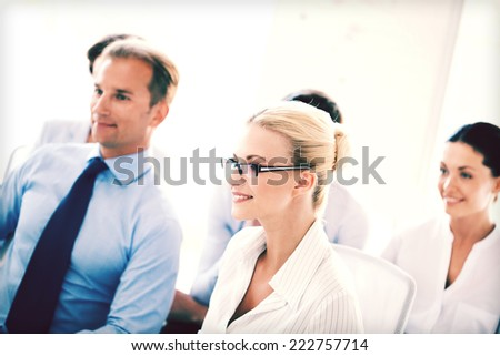 picture of smiling businessmen and businesswomen on conference - stock photo