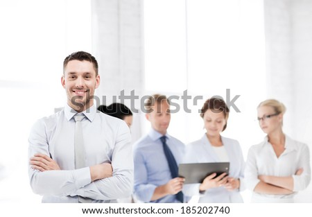 picture of smiling handsome businessman in office - stock photo
