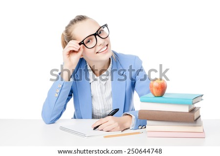 picture of smiling student with stack of books. Isolated. - stock photo