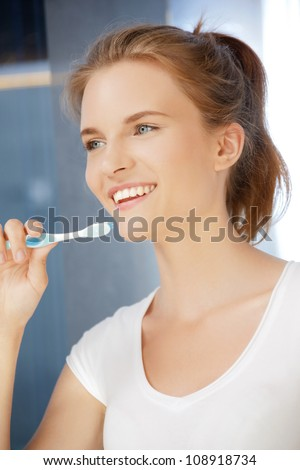 picture of smiling teenage girl with toothbrush - stock photo