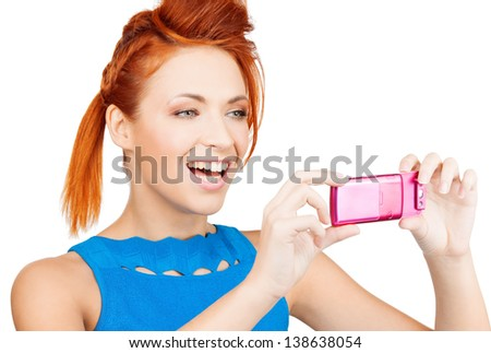 picture of smiling woman with cell phone taking photo - stock photo