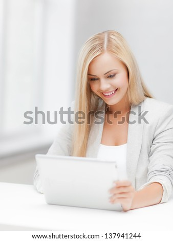 picture of smiling woman with tablet pc - stock photo