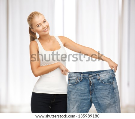 picture of sporty woman showing big pants - stock photo