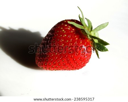 Picture of strawberry with shadow on white background.