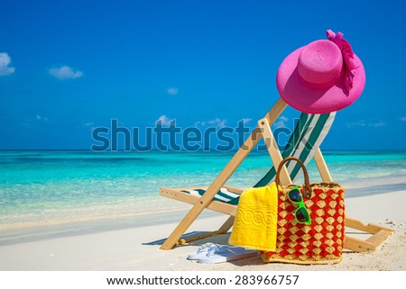 Picture of sunglasses on the tropical beach, vacation. Traveler dreams concept