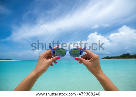 Picture of sunglasses on the tropical beach, vacation. Traveller dreams concept
