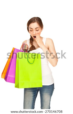 Picture of surprised beautiful woman with colorful shopping bags - stock photo