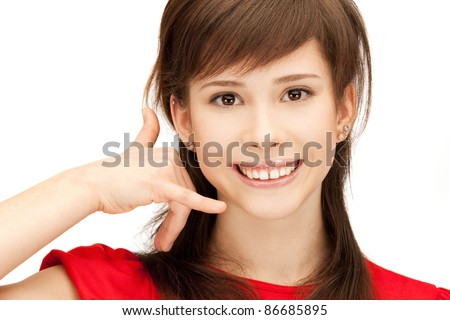 picture of teenage girl making a call me gesture