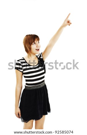 Picture of teenage girl pointing her finger. Isolated on white background - stock photo