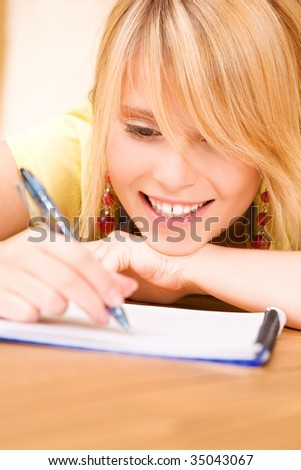 picture of teenage girl with notebook and pen - stock photo