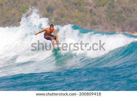 Picture of the Surfer in the Ocean.Lombok Island.Indonesia. - stock photo