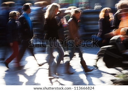 picture of the walking crowd in the city shown in motion blur - stock photo