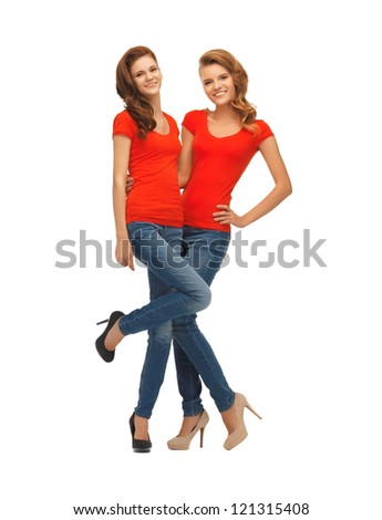 picture of two beautiful teenage girls in red t-shirts - stock photo