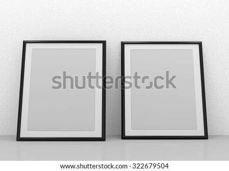 Picture of two black blank picture frames  - stock photo