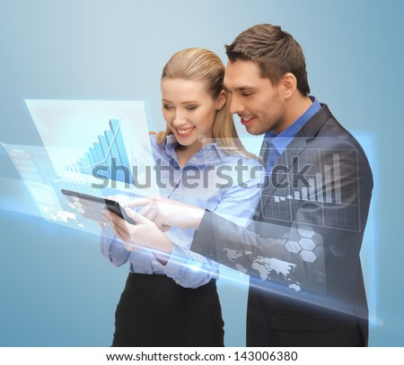 picture of two business people working with virtual screen - stock photo