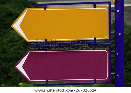 Picture of two colored and empty directional signs. - stock photo