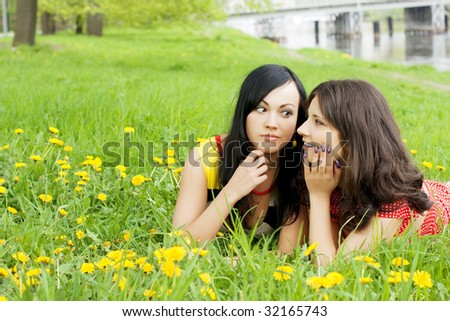 Picture of two girls who fissile secrets with each other