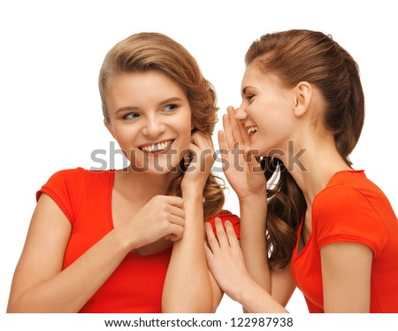 picture of two talking teenage girls in red t-shirts - stock photo