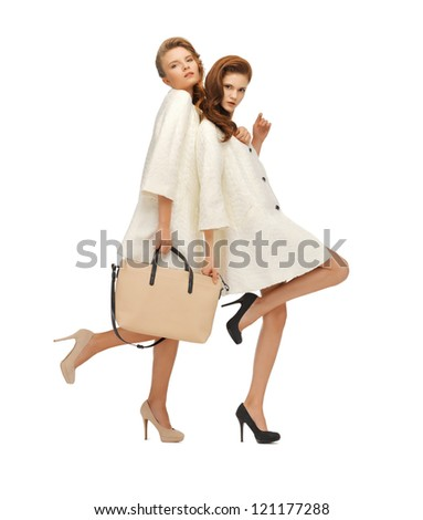 picture of two teenage girls in white coats with bag - stock photo