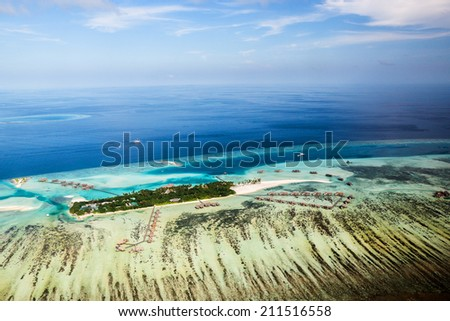 Picture of  typical Maldives resort taken from air - stock photo