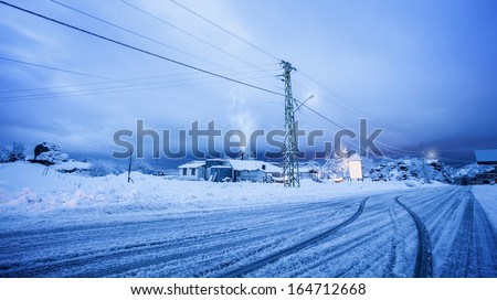 Picture of village covered with snow, beautiful New Year greeting card, snowy road in countryside, luxury villa on ski resort, snowfall in winter, wintertime holidays, cold weather - stock photo