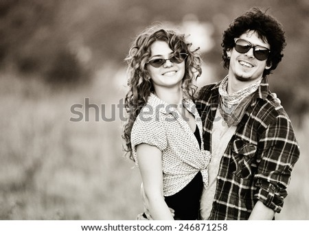 Picture of vintage way dressed yang pretty couple outdoor - stock photo